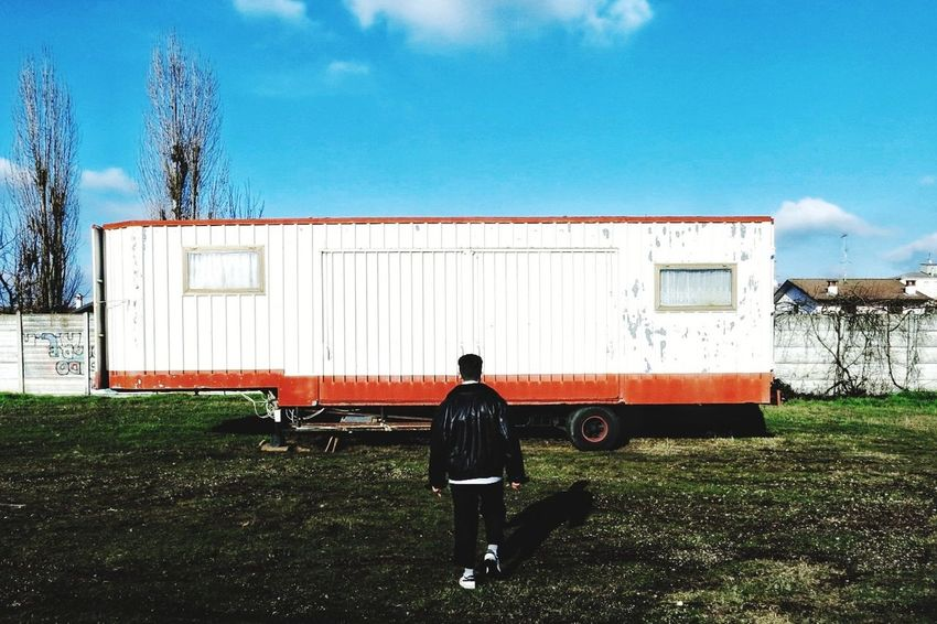 orizon Fantasy Colors Cold Temperature Warm Phusilly Cargo Container Freight Transportation Sky Occupation Transportation Working Outdoors Day Men Grass One Person People