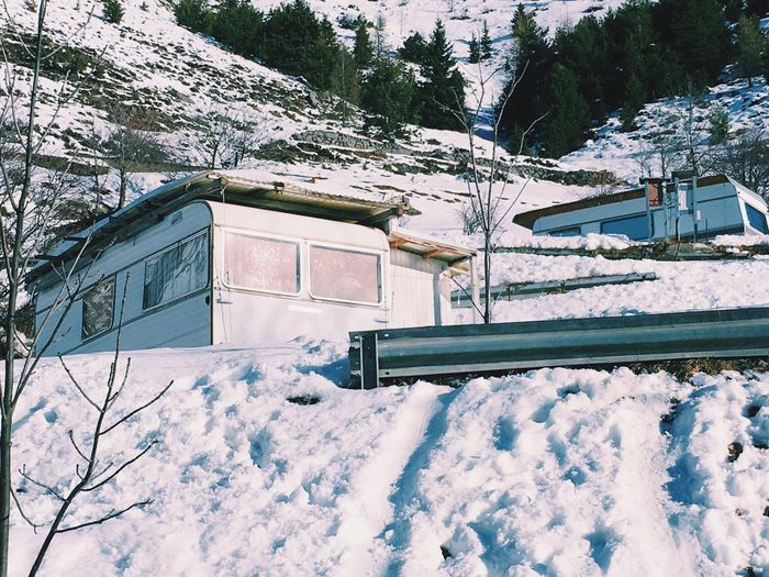 Low Angle View Of Trailer Home On Snow Covered Mountain