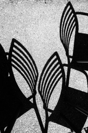 Arangment Black And White Chairs Light And Shadow Light Play Pattern Pavement Shadows