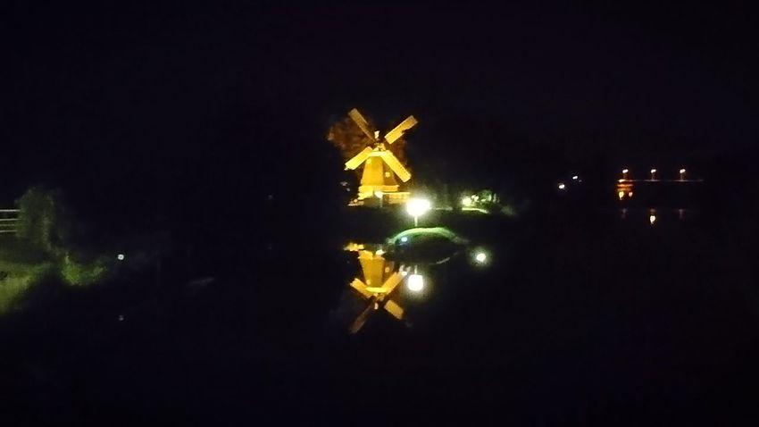 The windmill. Meppen Germany Windmill Windmills Night Night Lights Night Photography Obscure Mystery City Lights Urban Landscape Darkness Ahead City Cityscape Illuminated Black Background Sky