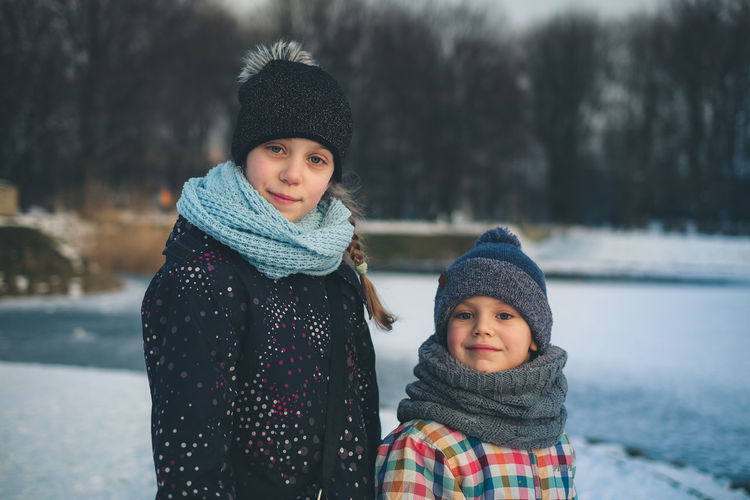 FUJIFILM X-T10 Bonding Childhood Close-up Cold Temperature Day Focus On Foreground Friendship Fujifilm Girls Knit Hat Looking At Camera Outdoors People Portrait Real People Scarf Smiling Snow Togetherness Two People Warm Clothing Wasiak Winter This Is Family The Portraitist - 2018 EyeEm Awards