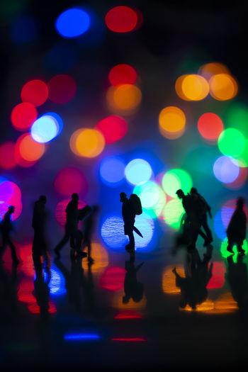 Defocused image of people enjoying at night