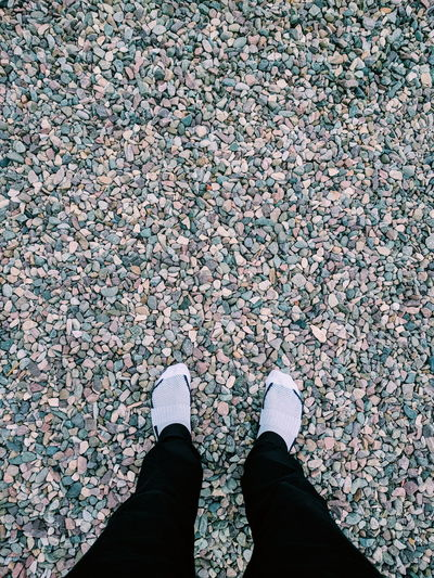 Stepping stones. Human Leg Low Section Standing High Angle View One Person Men Outdoors Sunny Summertime Travel Sunlight Tranquility No People Travel Destinations Stone Stones And Pebbles Pebble Pebbles Pebbles Pattern Pebbles In Nature Stones Composition