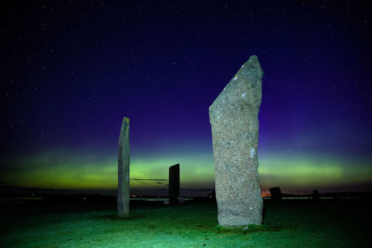 Northern light with stones of stenness, orkney islands, uk.