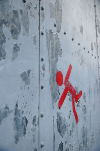 Close-up of red paint on wall
