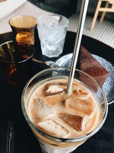 High angle view of iced coffee in glass on table