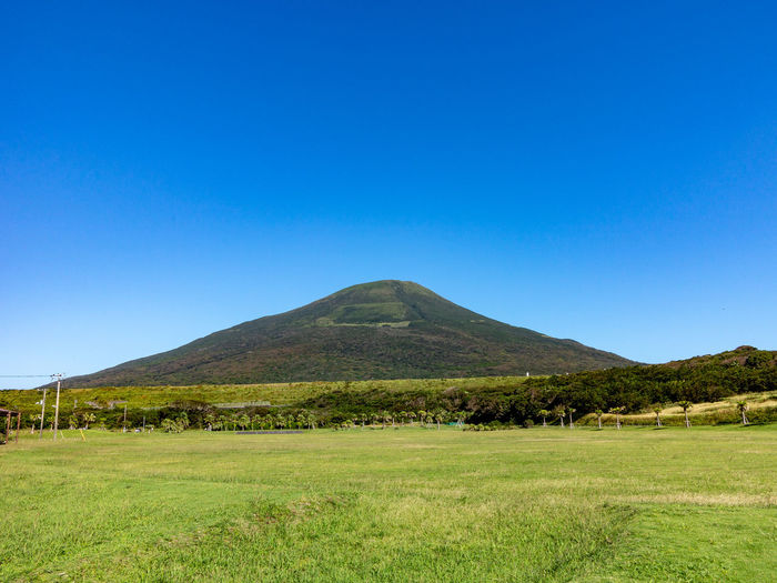 G1X Hachijo-Fuji Beauty In Nature Blue Clear Sky Copy Space Day Grass Green Color Land Landscape Mountain Nature No People Outdoors Plant Scenics - Nature Sky