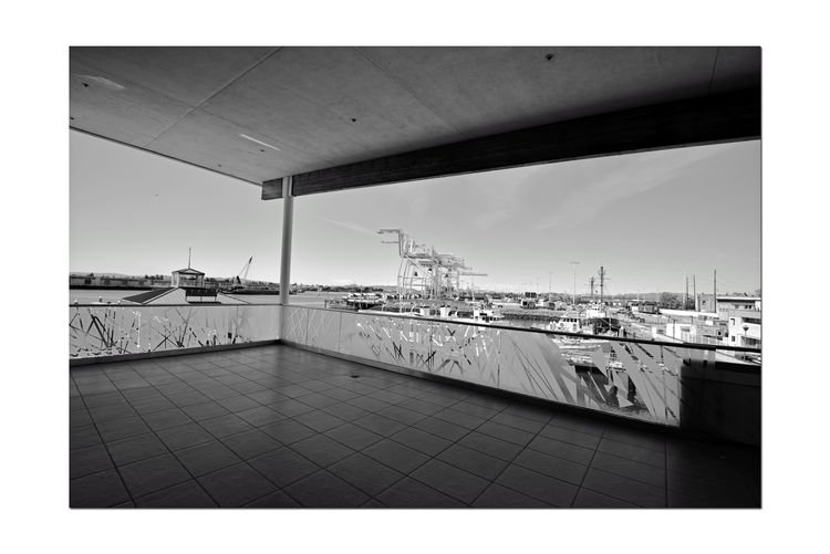 Ferry Landing Building 7 Observation Deck Jack London Square Port Of Oakland Ca Waterfront Designed From The Maritime Vernacular Retail And Office Building 32,000 Sq. Ft. Industry Meets Retail Working Port Entertainment District Port Cranes Overlooks The Ferry Landing & Dock Embarcadero Cove Etched Glass Oakland To San Francisco Ferry Black & White Black And White Black And White Collection  Monochrome Black And White Photography