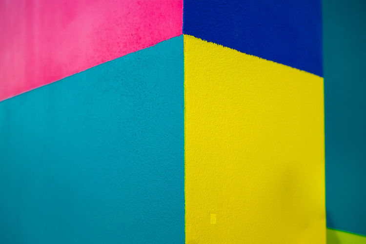 Abstract geometric pattern on concrete wall Architecture Art And Craft Backgrounds Blue Built Structure Close-up Creativity Design Flag Full Frame Indoors  Multi Colored No People Pattern Red Shape Textured  Variation Vibrant Color Wall - Building Feature Yellow