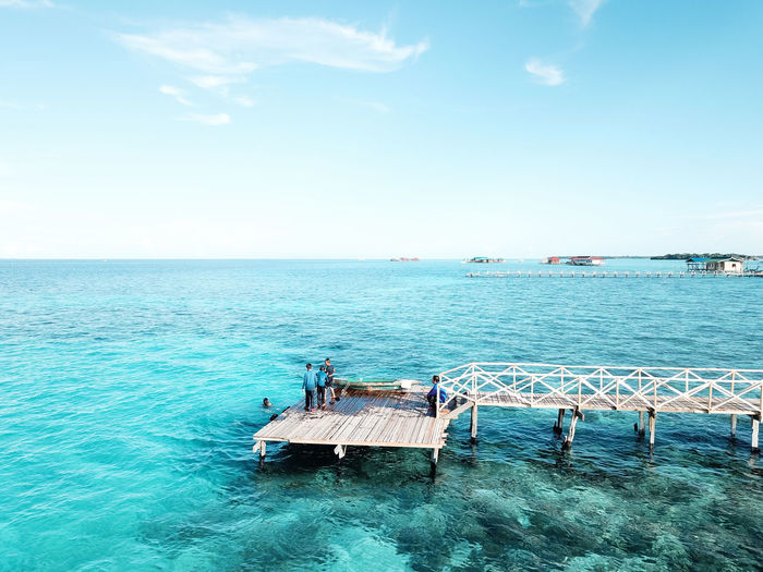 Aerial view of children playing at pier, in semporna, borneo sabah, malaysia.