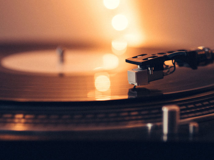 I like vinyl because I love music Arts Culture And Entertainment Circle Close-up Dark Focus On Foreground Glowing Illuminated Indoors  Music Musical Equipment Musical Instrument No People Record Player Selective Focus Table Technology Things I Like Vinyl Vinyl Records
