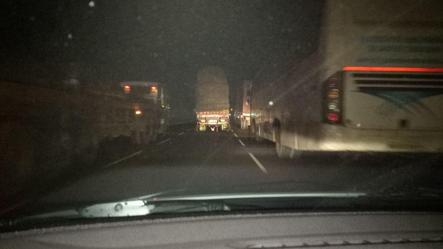 Night Night Travel Road Vehicle Truck Transport Transportation Illuminated City Road Spraying Land Vehicle Car Street Car Interior City Street Driving Car Point Of View Traffic Accident Crash Bumper Headlight Vehicle Light Tail Light