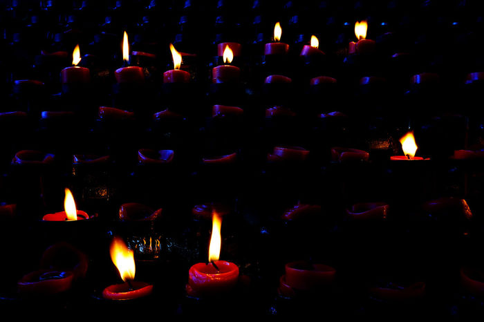 Abundance Arrangement Burning Candle Candlelight Candles Burning Candles Of Faith Close-up Dark EyeEm Best Shots Eyeem Philippines Flame Glowing Heat - Temperature Illuminated In A Row Large Group Of Objects Light Lighting Equipment Lit Night Red Candles Repetition Side By Side The Week On EyeEm
