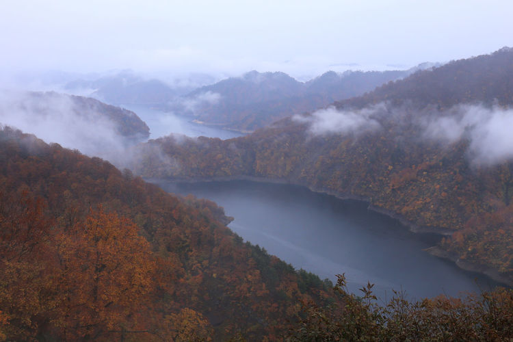 Scenic view of lake and mountains during autumn