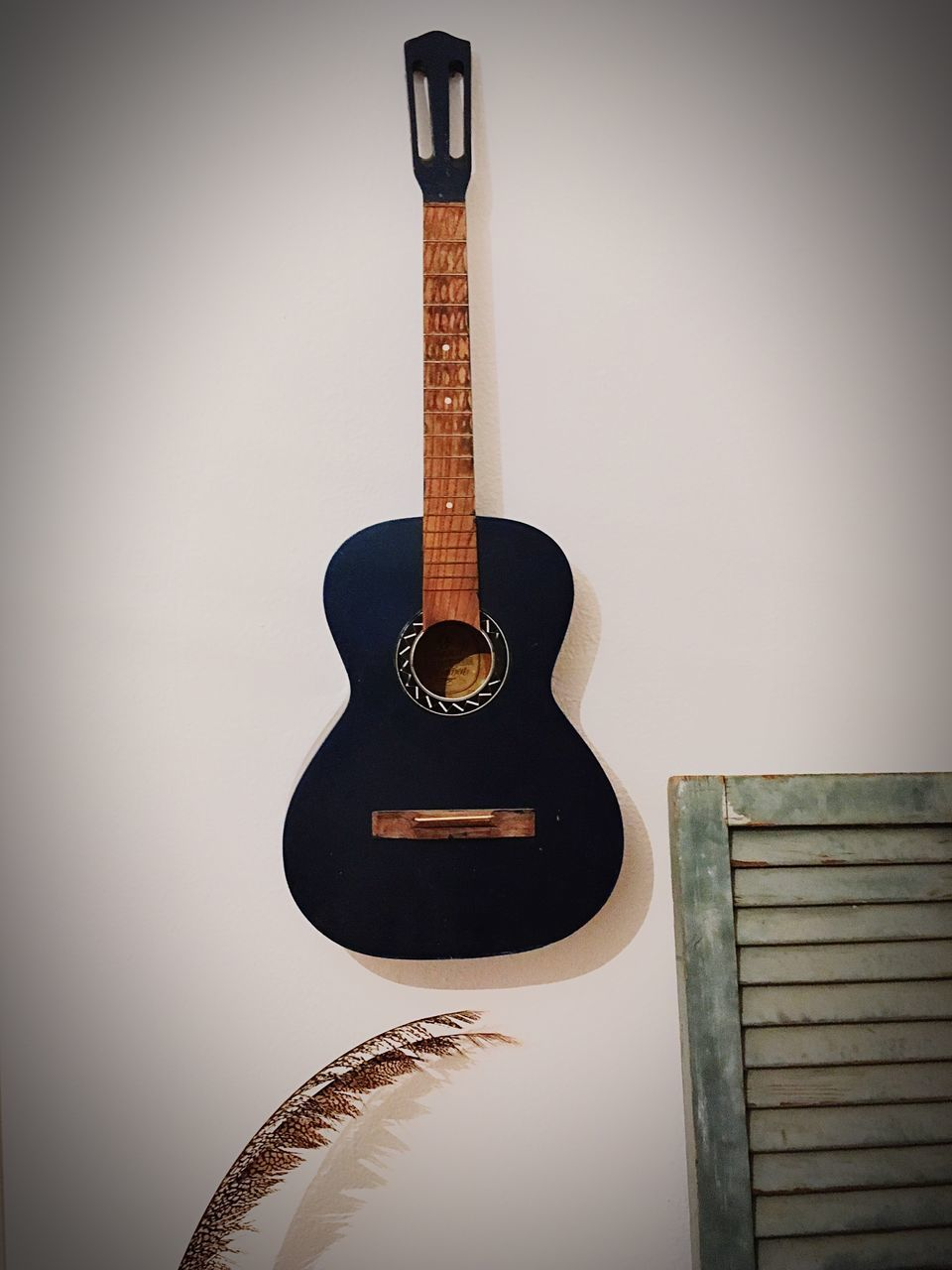 wall - building feature, guitar, music, indoors, no people, musical instrument, vignette, electric guitar, musical instrument string, close-up, day