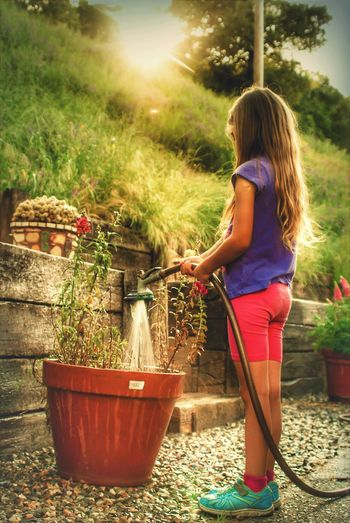 Standing Full Length Front Or Back Yard Blond Hair Summer Lifestyles Child Childhood Outdoors Tree Young Adult Nature Young Women Day EyeEm Best Shots EyeEmNewHere EyeEmBestPics EyeEm Gallery Portrait Feeling Creative Scenics Gardening Art Photography Looking Down Long Hair