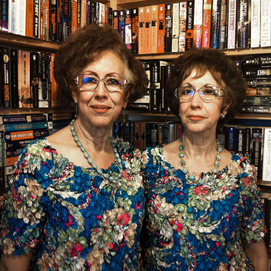 Environmental Portrait Adult Adults Only Bookshelf Brown Hair Eyeglasses  Happiness Indoors  Looking At Camera Mature Adult People Portrait Shelf Smiling Standing Twins Two People Women