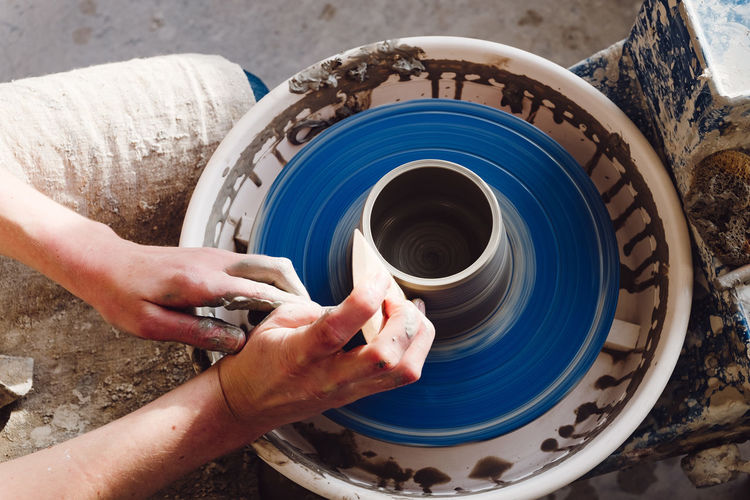 Cropped hands of potter making earthenware