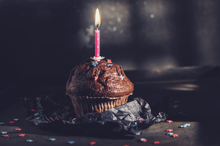 Cupcake with birthday candle Burning Candle Celebration Chocolate Copy Space Event Happy Holiday Homemade Retro Sugar Baked Bakery Birthday Brown Crumpled Paper Cupcake Dark Food Photography Fire Foodporn Gift Muffin Present Sprinkles Sweet Food