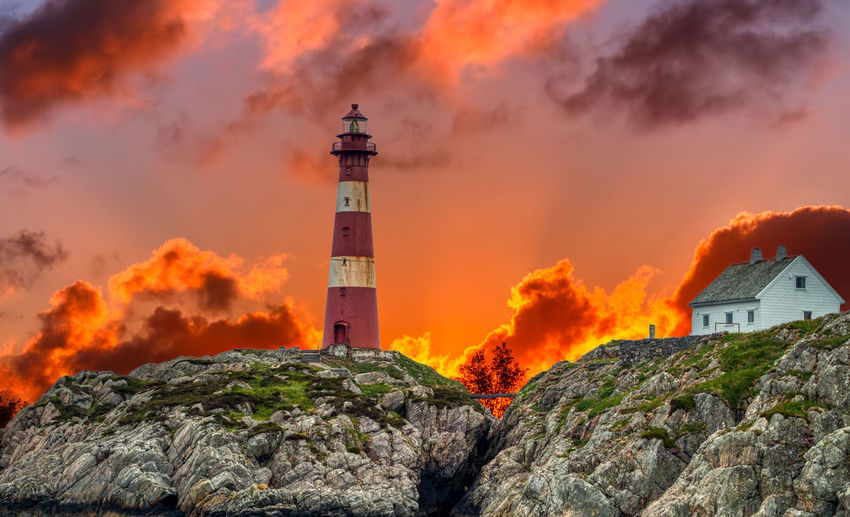 Dramatic sunset. Built Structure Building Architecture Building Exterior Guidance Tower Lighthouse Sky Burning Nature Orange Color Fire No People Accidents And Disasters Cloud - Sky Sunset Flame Sign Communication Warning Sign Outdoors