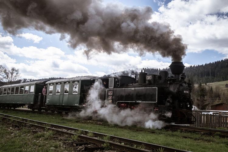 Train on railroad track against sky