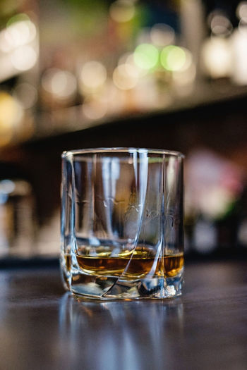 glass of whiskey on the bar top Glass Table Drinking Glass Refreshment Drink Glass - Material Focus On Foreground Transparent Household Equipment Close-up Food And Drink Whiskey Bar - Drink Establishment Freshness Selective Focus Still Life Alcohol No People Reflection Alcoholic Drink Indoors  Malt