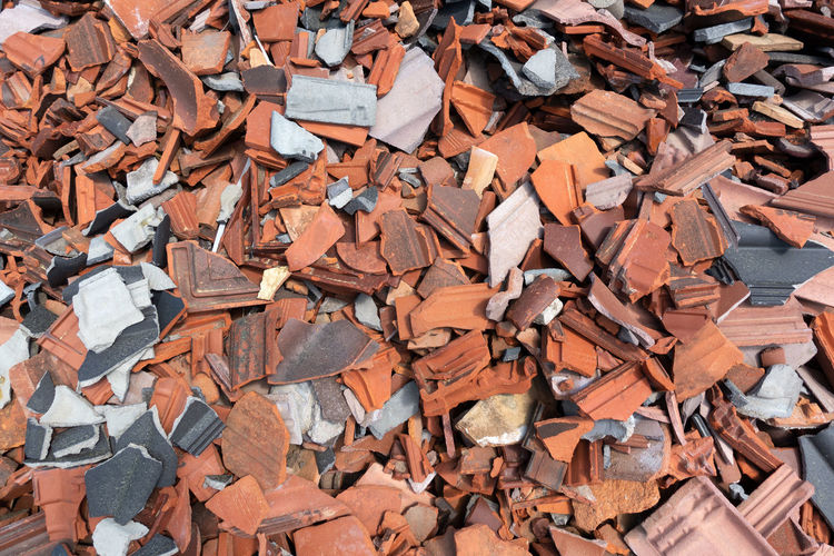 Heap of many, old, broken roof tiles in close-up Broke Building Rubble Construction Industrial Industry Messy Red Smashed Architectural Background Breakage Broken Bust  Chaotic Clay Close-up Damaged Heap Kaput Many Material Old Roof Tile Rubble Tile