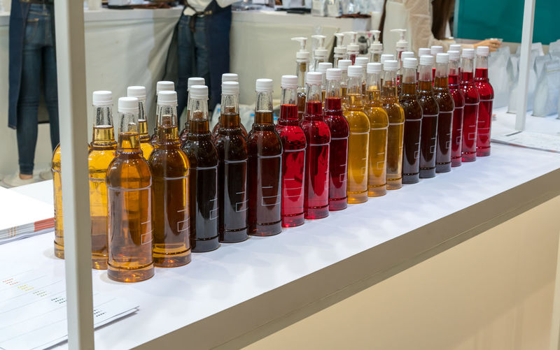 Syrup in bottles at store
