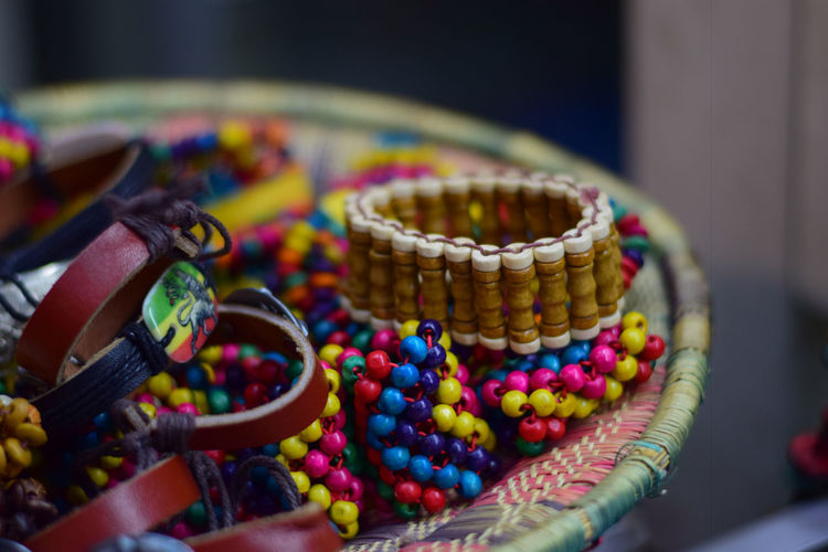African wear EyeEm Best Shots Abundance Arts Culture And Entertainment Bead Bracelet Choice Close-up Container Creativity Day Focus On Foreground Group Indoors  Jewelry Large Group Of Objects Multi Colored No People Personal Accessory Selective Focus Still Life Table Variation The Still Life Photographer - 2018 EyeEm Awards