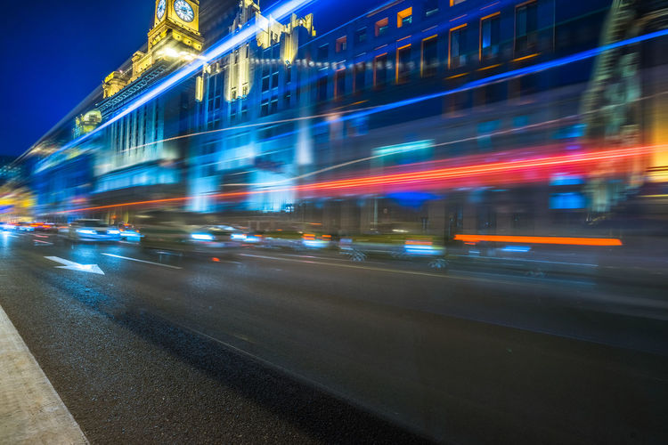 Blurred motion of vehicles on road at night