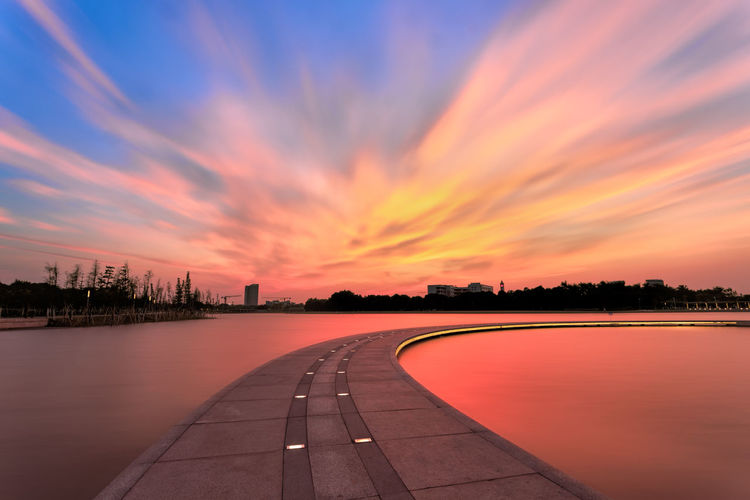 Sunset at Wenhanhu park, Foshan, China Background Beautiful Bright Clouds Colorful Dock Dusk Harmony Horizon Lake Landscape Night No People Outdoors Path Peace Red Reflection Road Scenery Sky Sunlight Sunset Tranquil Water