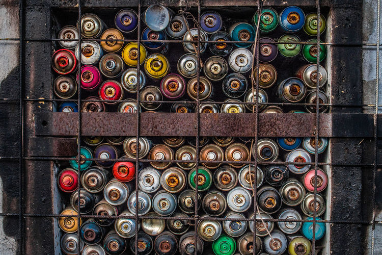 Full frame shot of colorful spray paint cans