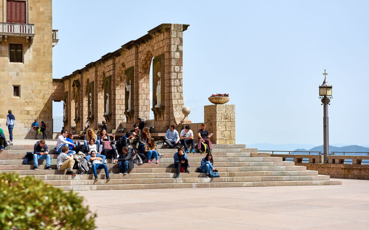 Montserrat, Spain - April 6, 2016: Tourists visiting famous place near Barcellona - The Benedictine abbey of Santa Maria de Montserrat. Catalonia, Spain Ancient Architecture Architecture Benedictine Monastery Church Editorial  Europe History Landmark Large Group Of People Montserrat Monastery Monument Outdoors People Religious Architecture Sacred Sanctuary  Santa Maria De Montserrat Scenery SPAIN Sunny Day Tourism Tourist Attraction  Tourists Travel Destinations