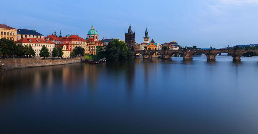 Scenic view of vltava river in city