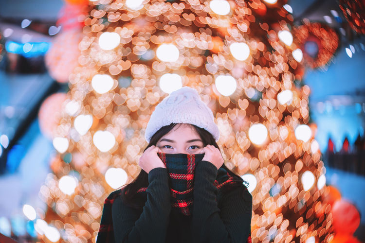 Portrait Of Woman In Illuminated Park During Winter