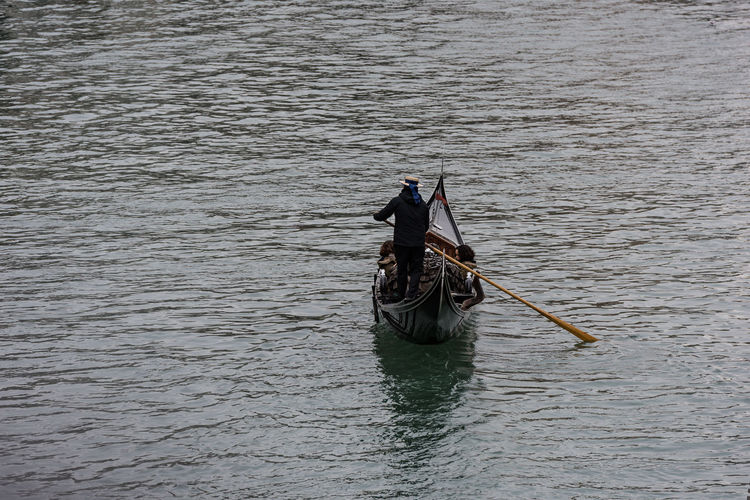 Man sitting on boat in water