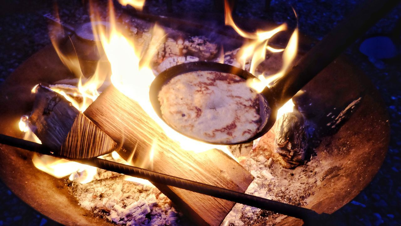heat - temperature, burning, fire, flame, fire - natural phenomenon, glowing, wood - material, nature, wood, close-up, no people, log, motion, indoors, firewood, high angle view, illuminated, night, food and drink, environment, bonfire