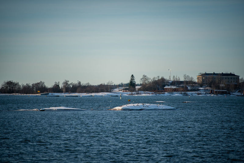 Beauty In Nature Cold Day Finland Helsinki Nature Nautical Vessel Outdoors Pedal Boat People Scenics Sea Sky Suomenlinna Tranquility Travel Destinations Tree Water Winter Wintertime