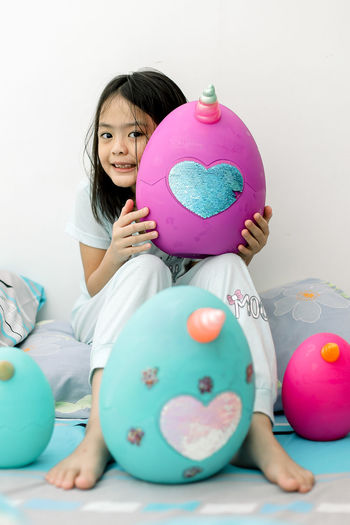 Portrait of cute girl with balloons
