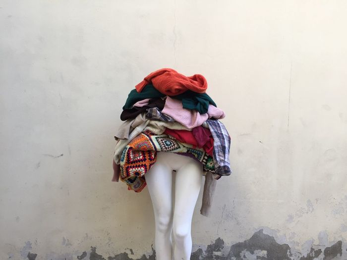Clothes on mannequin against wall