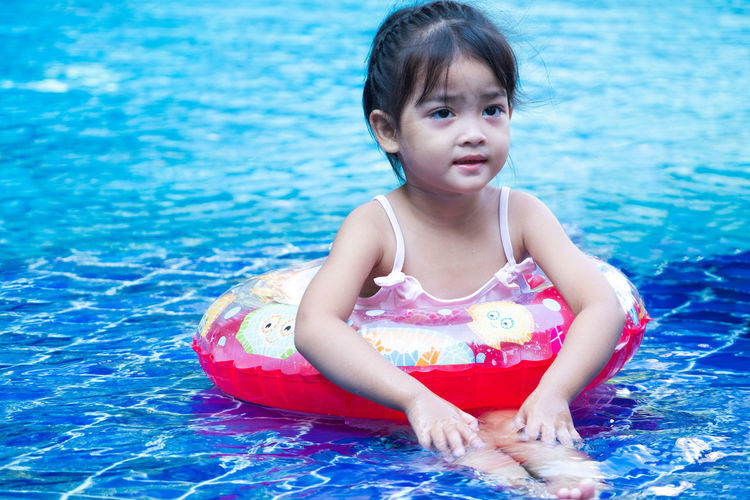Portrait of cute little asian girl having fun and smiling in swimming pool, floating in blue refreshing water with colurful rubber ring Girl Kid Swimming Pool Life Ring Water Child Fun Play Young Outdoor Cute Happy Smiling Enjoy Relax Float Blue Summer Vacation Lifestyle Swim Holiday Wet Childhood Activity Fresh Leisure Healthy Refreshing Caucasian Sunlight Little Rubber Sun Happiness Sport Relaxation Smiling Nature Beauty Family Asian  Aqua Funny Floating Liquid Playful Smile The Portraitist - 2019 EyeEm Awards