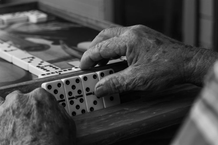 Cropped hands playing domino