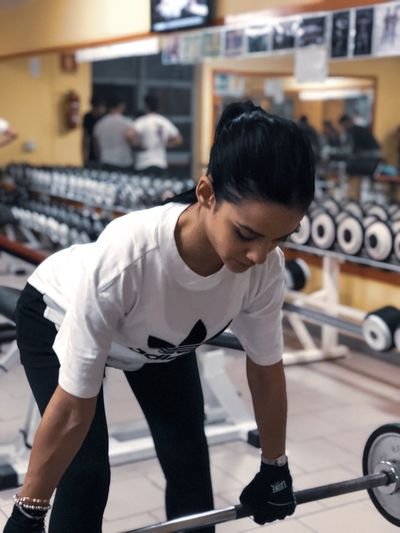 One Person Exercising Strength Sport Lifestyles Healthy Lifestyle Sports Training Full Length Adult Weight Training  Sports Clothing Gym Young Men Men Muscular Build Young Adult Clothing Weight Body Conscious Athlete
