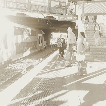 Sunlight Real People Two People Taking Photos Street Life Streetphotography Railway Track Rail Transportation Train Station Train Platform Waiting Morning Light Morning Mondaymorning Work Day People City Cityexplorer CityWalk Light And Shadow Light And Shadows light and reflection Steps And Staircases Shadows & Lights Shadows