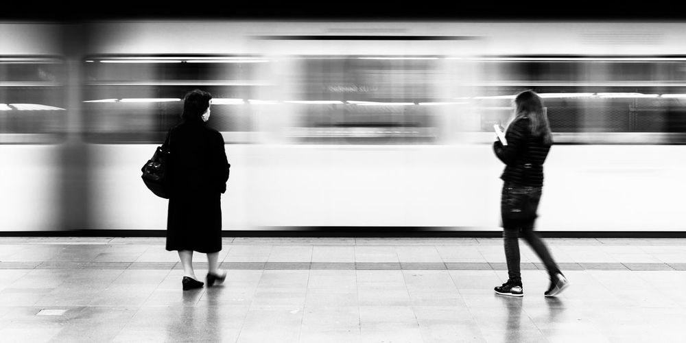 Full length of women at subway station