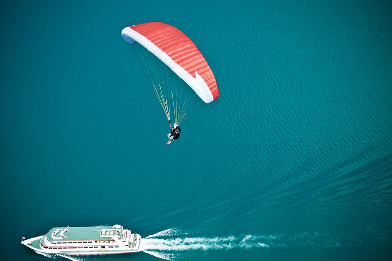 Aerial View Of Paragliding Over Boat In Sea