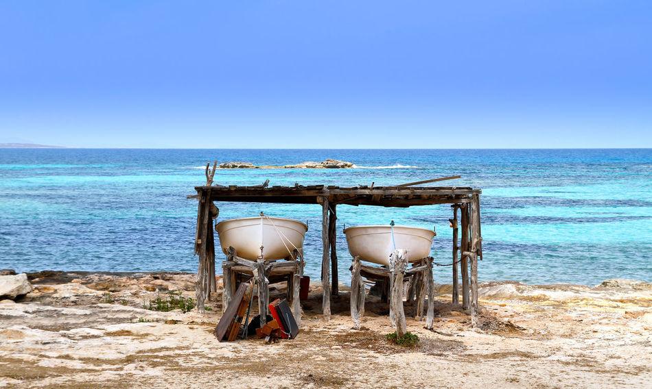 two boats beached in formentera island, spain Balearic Islands Beach Beachphotography Formentera Island Horizon Over Water Ibiza Mediterranean Sea Moored Sailboat Sea SPAIN Summer Sun Tourism Tranquility Travel Travel Destination Travel Destinations Water