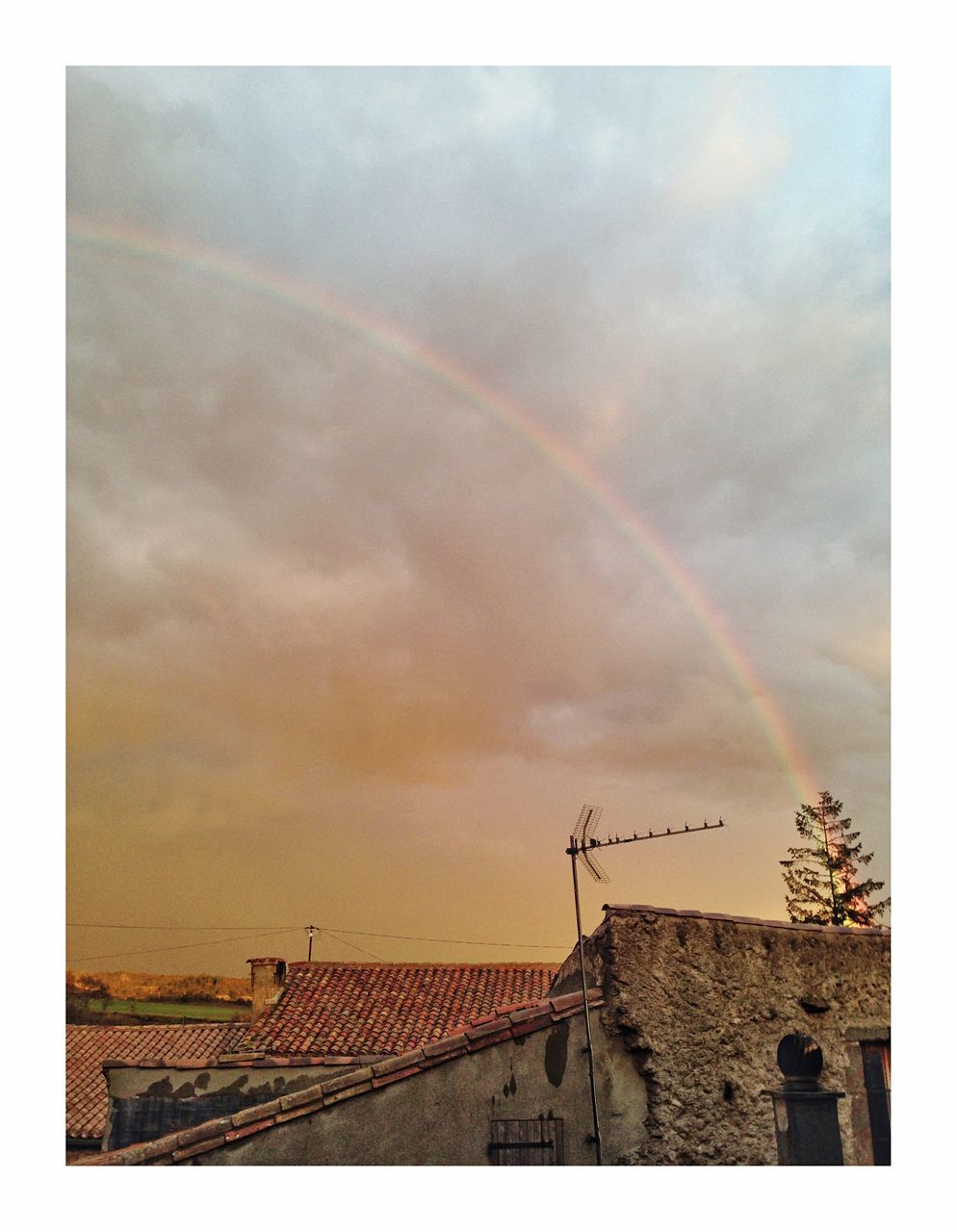 building exterior, rainbow, built structure, architecture, sky, cloud - sky, outdoors, double rainbow, day, scenics, no people, beauty in nature, nature, vapor trail, windmill