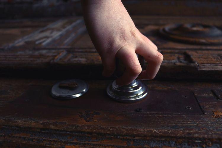 Cropped hand holding door knob