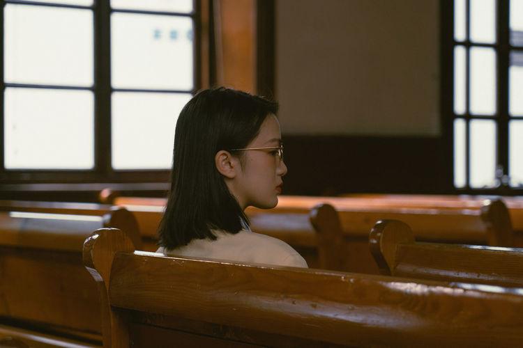 Portrait of teenage girl sitting on table